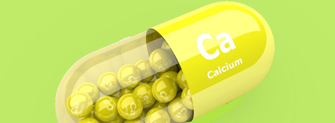 capsula con grajeas de calcio en el interior
