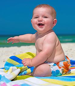 bebe, sol y playa
