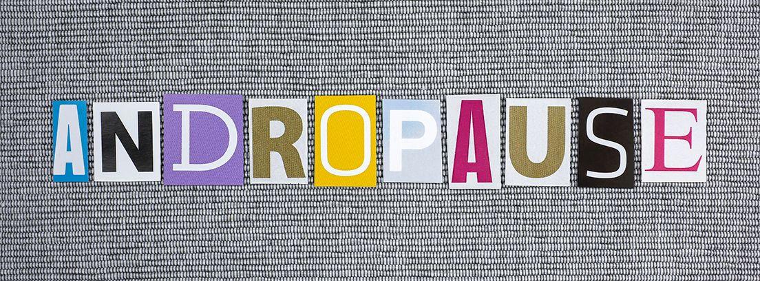 letras de diferentes colores sobre fondo gris con la palabra menopausia
