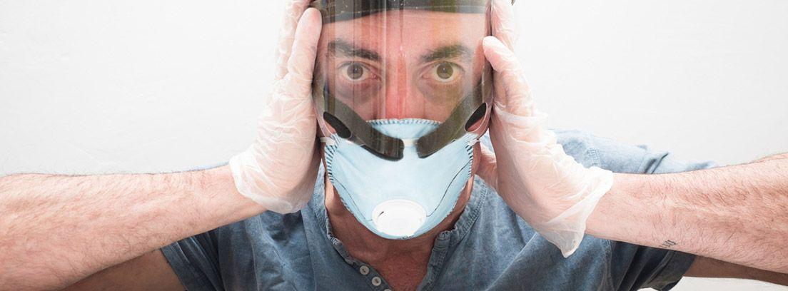 Controlar el miedo a la epidemia: hombre con una mascarilla y las manos sobre ella