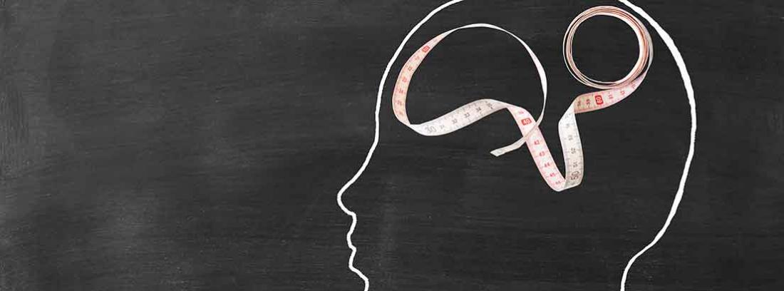 imagen de silueta de cabeza con cinta metrica en su interior
