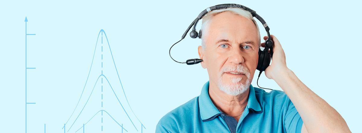 Otosclerosis: hombre mayor con unos aparatos para la medición de audición y un diagrama